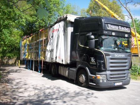 Eco house kit arrives on a lorry from Europe by B. Isachsen